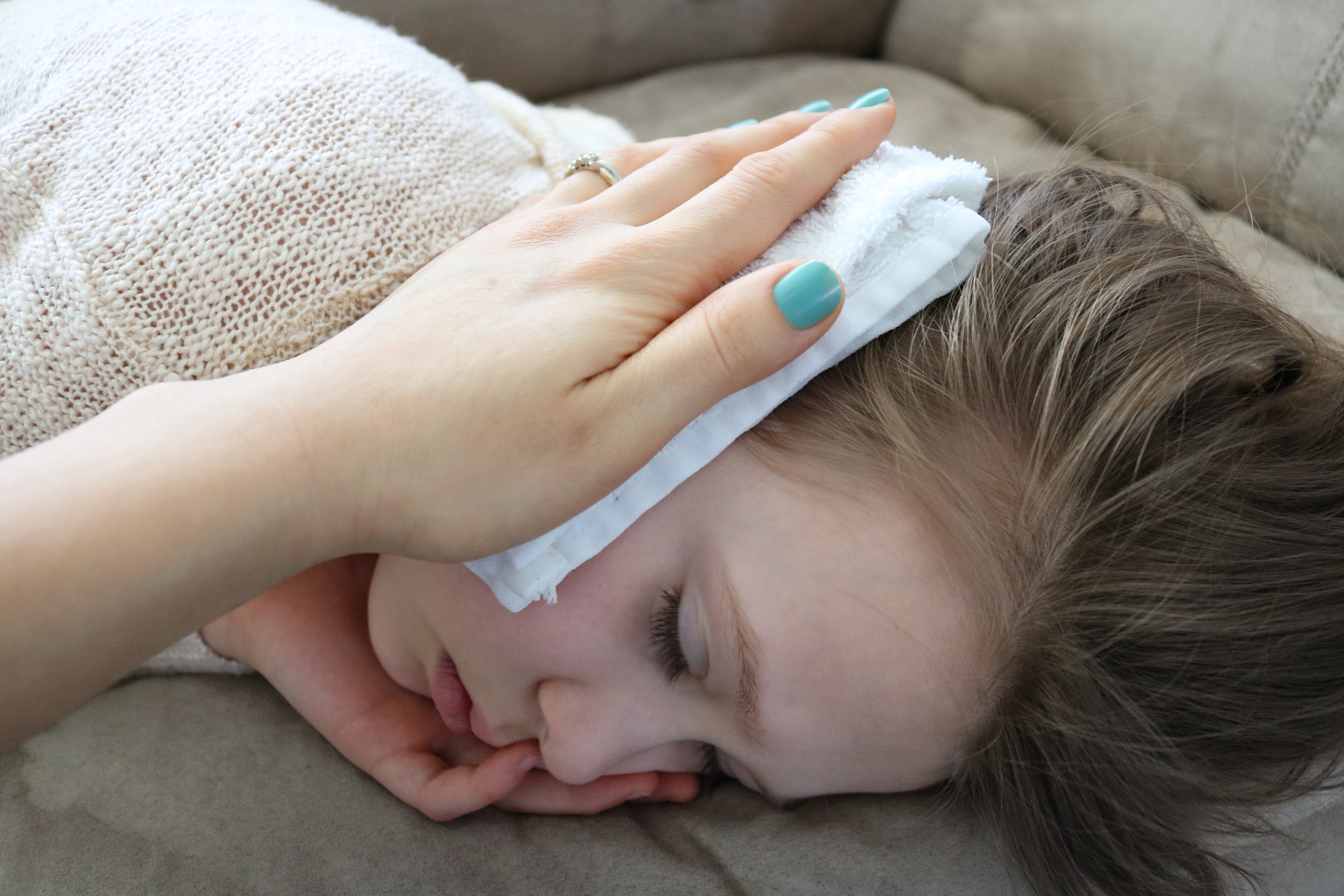Wet, warm washcloth over the ear to help with earache, ear infection.
