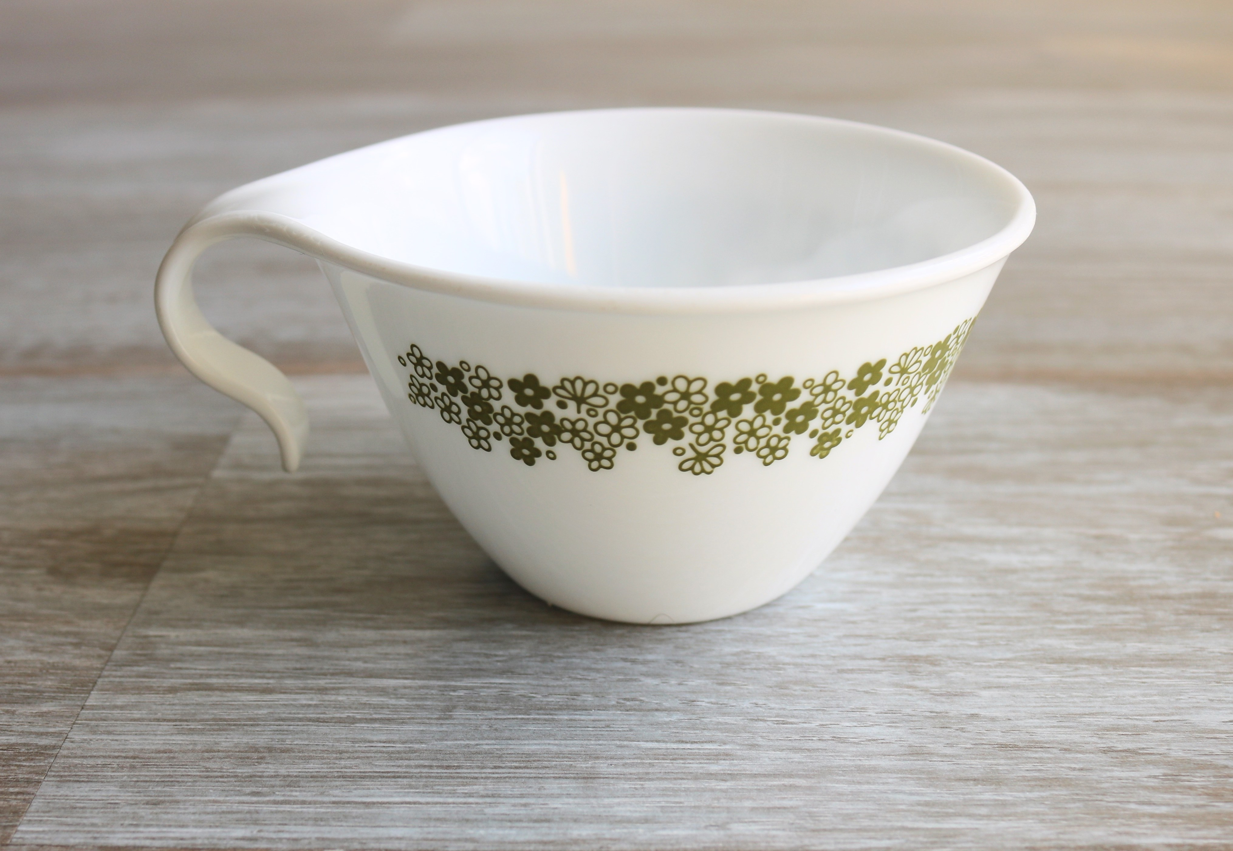 Cup that doesn't break easily to make garlic oil infusion. Treats ear infections.