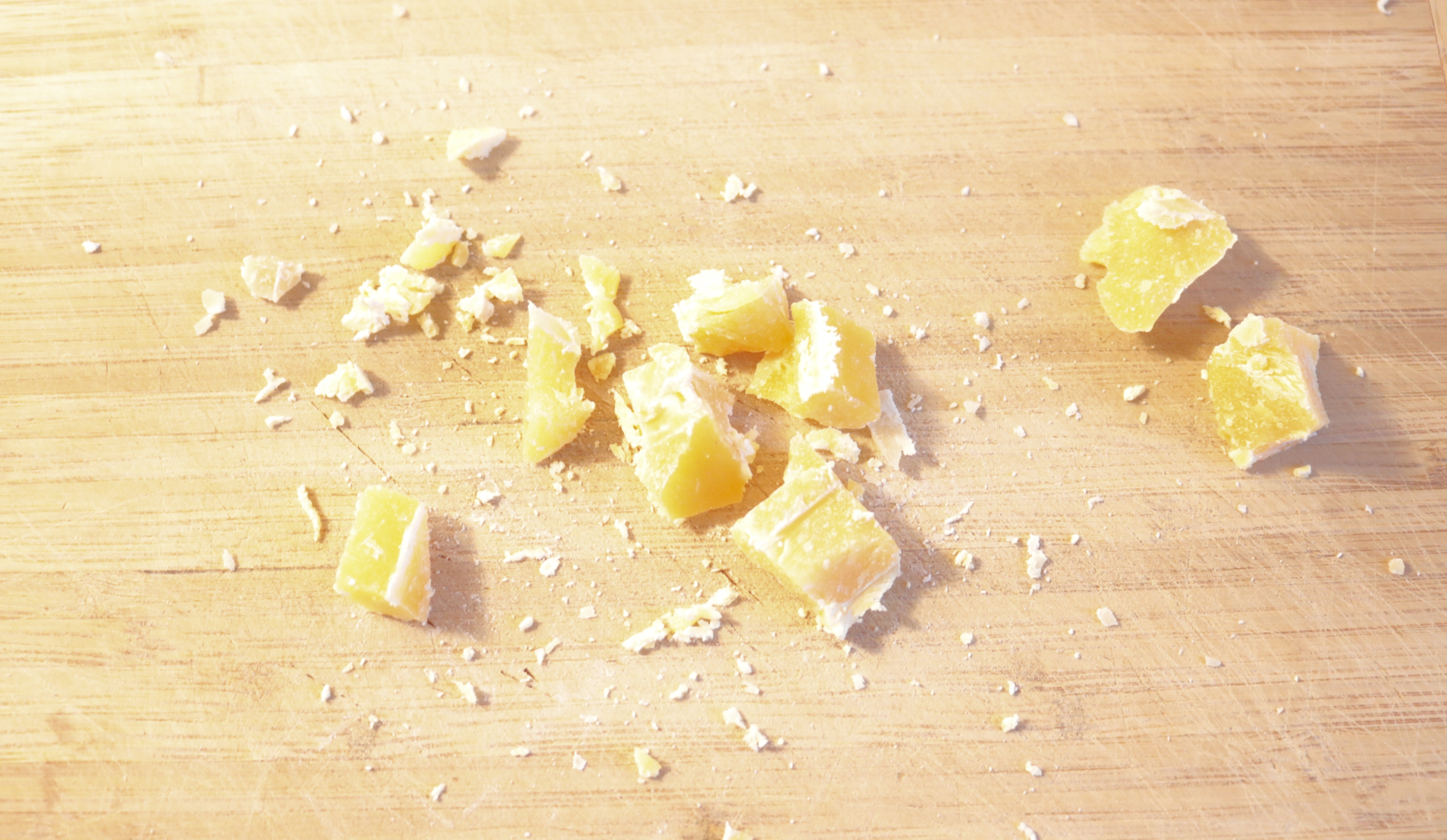 Pieces of crushed bees wax then goes to the warmed up oil for melting.